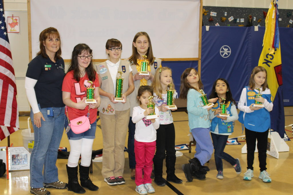 Members of Girl Scout Troop 641 display their trophies.  The following scouts won awards: Alyssa Harris (1st Place), Lilly Stahlman (2nd Place), Mia Farris (3rd Place), Maddy Morgan (Most Energy Efficient), Celina Zabala (Scouts' Choice), Allison Hill (Most Patriotic), Ellie Lively (Best Scout Theme), and Kate Wexell (Best Use of Imagination).