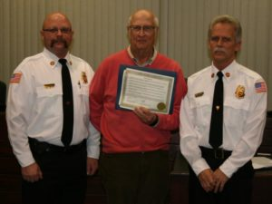 Pictured from left: Fire Chief Brent Saunders, Mayor Gary Graham, and Craig Schmidt (Submitted Photo)