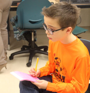 Aiden interviews a classmate for the Moye School Newspaper. (O'Fallon Weekly Photo by Nathan Poignee)