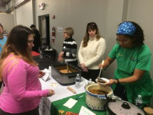 A member of the O'Fallon Garden Club serves up some soup at the Empty Bowl Luncheon. (O'Fallon Weekly Photo by Nick Miller)