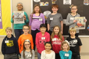 """The students in the """"School News"""" enrichment class at Moye Elementary worked to create their own school newspaper. They used copies of the O'Fallon Weekly to learn about the different elements of a newspaper. (O'Fallon Weekly Photo by Nathan Poignee)"""