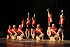 During the competition, the JV Golden Girls performed a special dance number. Singers Hannah Davenport, Aimee Stein, and Geryn VanZwienen perfomed during a break as well. (O'Fallon Weekly Photo by Nick Miller
