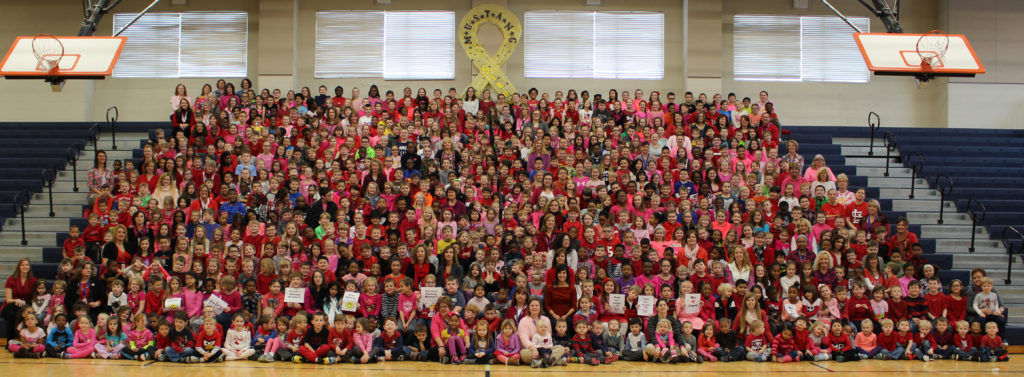 """The entirety of Delores Moye Elementary School, nearly 800 students, teachers, and school employees, wore pink and red on Thursday to show support for Janet. """"We're not wearing pink and red because its Valentine's Day. We're wearing them because they are Janet's favorite colors,"""" said Principal Becky Williams. (O'Fallon Weekly Photo by Nick Miller)"""