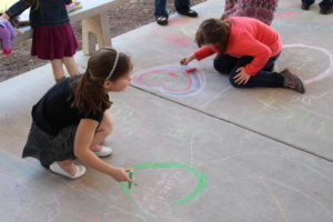 Classmates covered the sidewalk at Moye Elementary with messages of support for Janet and her family. (O'Fallon Weekly Photo by Nick Miller)