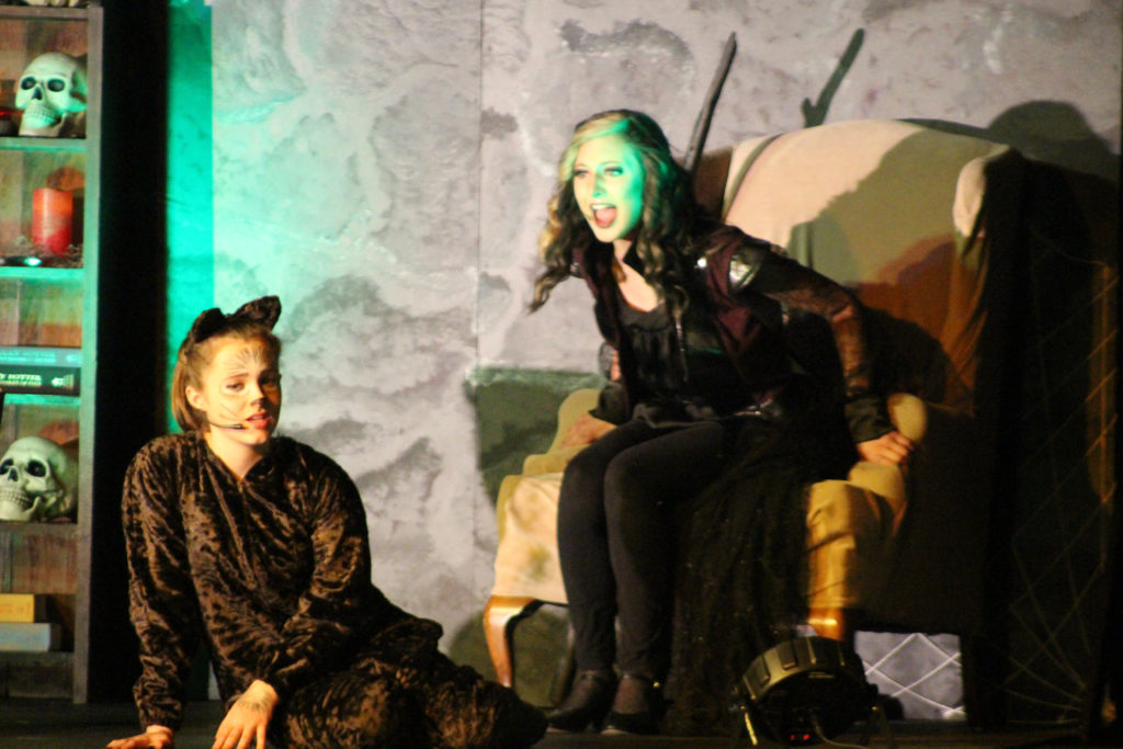 Evilina, played by Hannah Bennion, is upset she didn't receive an invitation to the Princess's birthday party. Also pictured is the Cat, played by Noelle Rousseau.