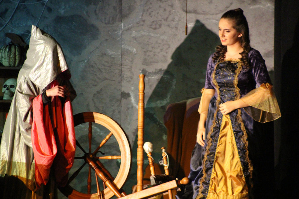 Evilina, dressed as an old crone, tempts Princess Briar Rose to prick her finger on the spinning wheel's needle. (O'Fallon Weekly Photos by Nick Miller)