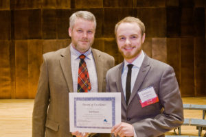 Dr. Isaac Slaven, associate professor of technology and member of the Thesis Awards Committee, presents Mark Rheaume with the Thesis Award of Excellence for the College of Arts and Humanities.  (Submitted Photo)