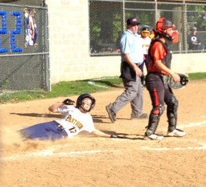 Freshman Ashley Schloer slides safely into home  (O'Fallon Weekly Photo by Rich Hull)