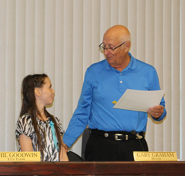 Mayor Gary Graham introduced Grace, who served as the Mayor for the Day. Grace is a fourth grade student at Faith Baptist Academy. She not only spent time with the Mayor at City Hall, but also visited the police department and fire department to learn how they operated. (O'Fallon Weekly Photo by Nick Miller)