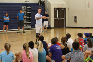 O'Fallon native Chris Van Etten speaks to junior high students about the importance of fitness. (O'Fallon Weekly Photo by Angela Simmons)