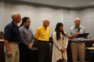 At Monday's City Council meeting, Mayor Gary Graham proclaimed June 20, 2016, as Milkheila Flores Day in O'Fallon. Flores is a Rotary Exchange Student from Mexico. Pictured from left: Rotarian Richard Lunan, O'Fallon Rotary Club President Matt Smallheer, Rotarian Ed True, Milkheila Flores, and Mayor Graham.  (O'Fallon Weekly Photo by Nick Miller)