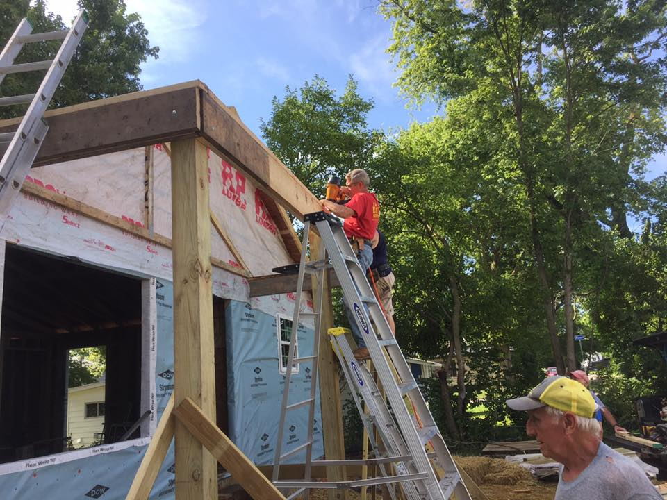 Gary Mueller and Jeff Greenstreet prepare the porch frame for the roof trusses. (Submitted Photo)