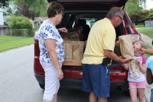 Kathy Scott and Allen Garner deliver a lunch to seven-year-old Barbara Wilson  (O'Fallon Weekly Photo by Becca Jones-Scales)