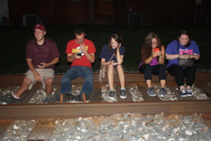 Friends took a break from walking around downtown O'Fallon to take advantage of lures set at Pokestops at the O'Fallon Historical Society and the caboose. From left to right: Matt Zawasky, Matt Rowewe, Laney Restoff, Stephanie Huller and Beckie Freeman. (O'Fallon Weekly Photo by Angela Simmons)