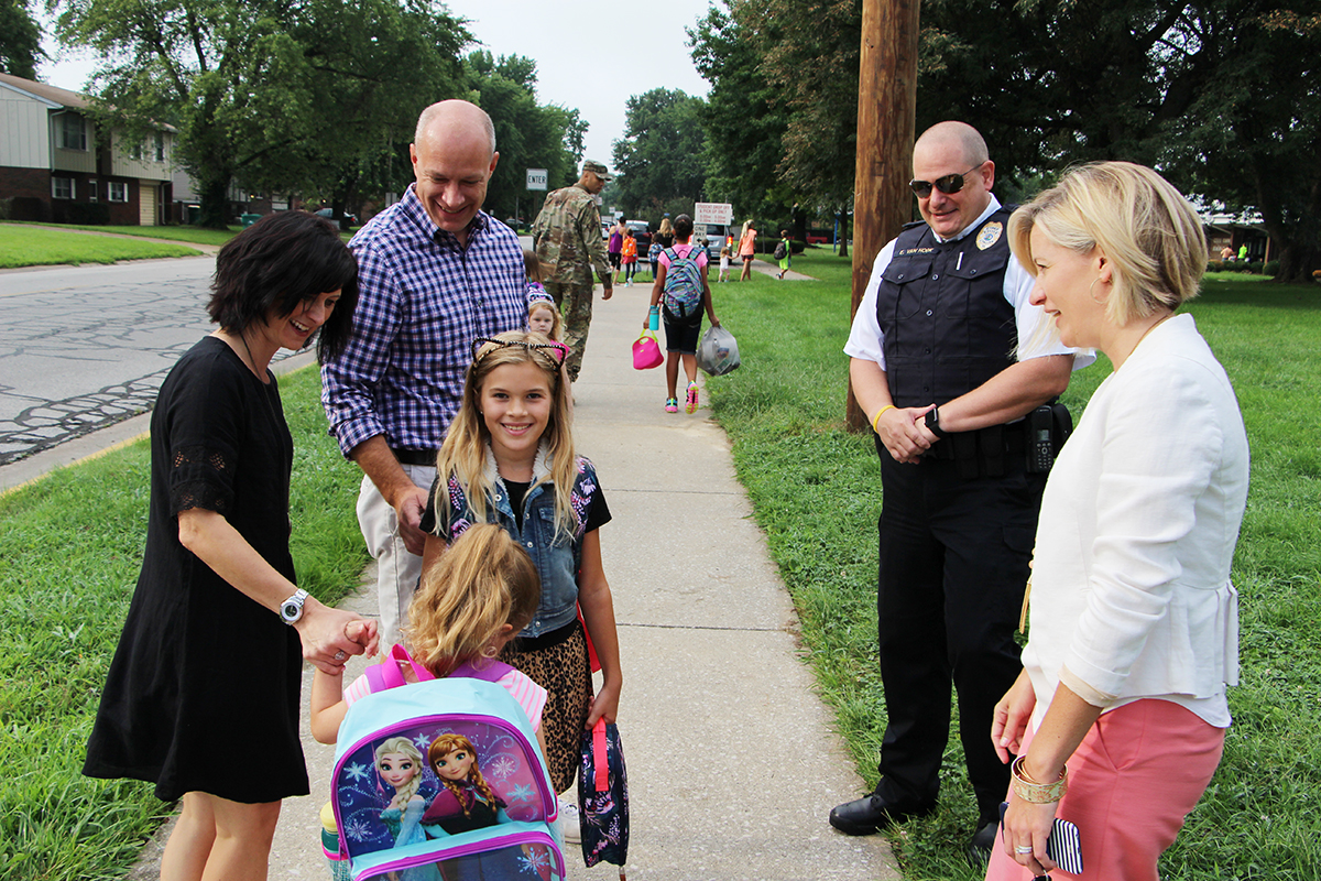 District 90 Superintendent Carrie Hruby and O'Fallon Police Chief Eric Van Hook were on hand to greet parents and students on the first day of school at Estelle Kampmeyer Elementary School. Van Hook took the opportunity to speak with parents about the improvements the city has made to crosswalks and school safety. Hruby travelled around to multiple schools in the district and read to younger students.   (O'Fallon Weekly Photo by Nick Miller)