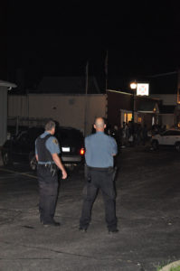 Police stand watch as a group of youths gather in front of the VFW. (O'Fallon Weekly Photo by Jeff Egbert)