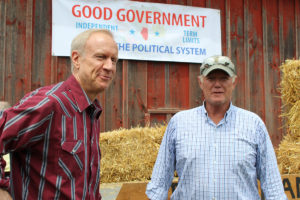 Governor Bruce Rauner (left) prepares to speak to a crowd gathered at Tiedemann Farm in Shiloh on Wednesday. Dave Tiedemann (right) hosted the Governor so he could discuss his proposals for independent legislative maps and term limits for state officials. (O'Fallon Weekly Photo by Jonathan McLean)