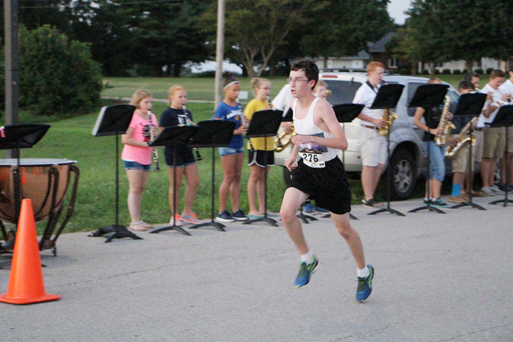 Fifteen year old Lucas Capistrant was the first racer to cross the finish line Saturday evening at the Lifelong Music in O'Fallon Schools Music of the Night 5K. (O'Fallon Weekly Photo by Nick Miller)