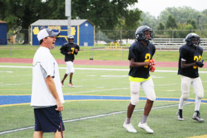 Head Coach Brandon Joggerst gives some instructions to his players during Saturday's practice. The Blue and Gold  scrimmage game is scheduled for Friday, August 19. (O'Fallon Weekly Photo by Nick Miller)