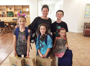 Families at Scott Air Force Base received supplies such as backpacks, writing tools, and notebooks.  (Submitted Photo)