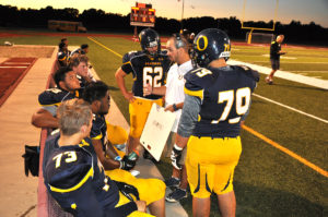 Coach Lewis talks with some members of the offensive line at a recent Panthers game. (O'Fallon Weekly Photo by Jeff Egbert)