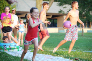 Grace Hellin takes off for third base during the Slip N Slide Kickball game. (Submitted Photo)