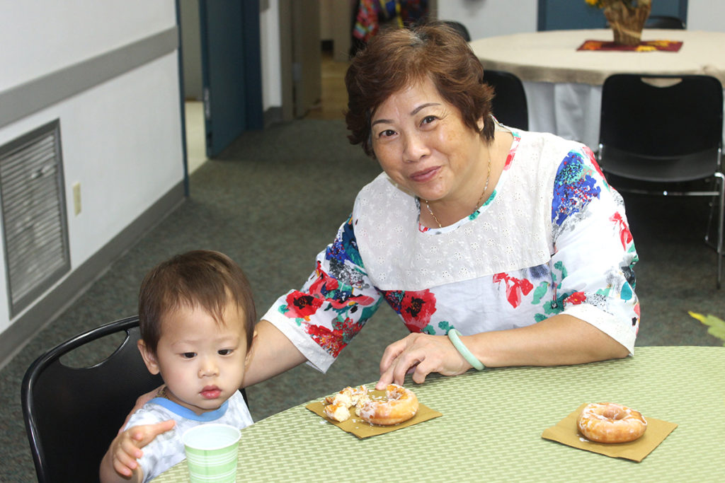 Aidan Lee shares a donut with his grandmother. (Submitted Photo)