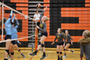 Senior Cassie Reno prepares to spike the ball at two Mater Dei defenders during the Tiger Classic Tournament on Saturday. (O'Fallon Weekly Photo by Nick Miller)