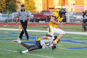 Running back Mason Hewitt jumps a defender to score his first touchdown of the evening, and the first for the Panthers, against the Normal West Wildcats last Friday. Hewitt would go on to score another touchdown and racking up 275 rushing yards on 29 carries. (O'Fallon Weekly Photo by Nick Miller)