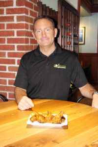 Hop House Southern Eatery owner Michael Durso with some of his award winning smoked chicken wings in a Carolina mustard sauce.  (O'Fallon Weekly Photo by Nick Miller)