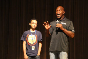 Evander Holyfield recognizes OTHS student Elijah Harris, whose aunt is a friend of Holyfield's. (O'Fallon Weekly Photo by Nick Miller)