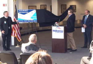 MidAmerica Airport Director Tim Cantwell (far Left) and St. Clair County Chairman Mark Kern look on as Lee Warren, Director of Planning for Allegiant, reveals Destin, Florida as the airline's newest destination to be served with direct flights from MidAmerica on January 12, 2016. (Submitted Photo)