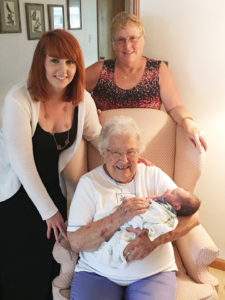 Four generations: Maggie with her daughter Pat, grand-daughter Laura, and great grandson Maxwell.