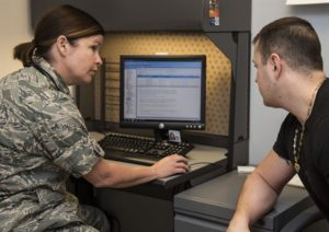 Maj. Tiffany Williams, Uniformed Services University of the Health Sciences doctoral student, speaks with a patient Aug.19, 2016, at Scott Air Force Base, Ill. In July of this year, for the first time ever, the 375th Medical Group became a training site for Family Nurse Practitioner students enrolled in USUHS.  (U.S. Air Force photo by Airman 1st Class Melissa Estevez)