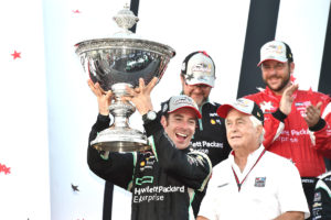 Simon Pagenaud hoists the Astor Cup after winning the 2016 Verizon IndyCar Series Season Championship (Photo by INDYCAR Photo – Chris Owens)