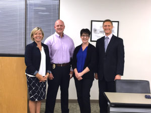 O'Fallon Police Captain Mark Berry is recognized as the new Director of Safety and Security for District 90. Pictured, from left: Superintendent Carrie Hruby; Capt. Mark Berry; his wife, Melissa Berry; and District 90 Board of Education President John Wagnon.