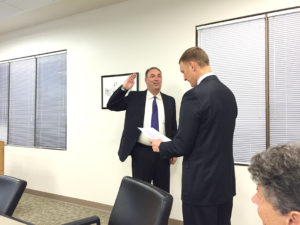 Matthew Lloyd being sworn in as a new member of the District 90 Board of Education by President John Wagnon.