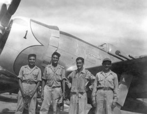 Captain Radames Gaxiola Andrade stands in front of his P-47D with his maintenance team after he returned from a combat mission. (Courtesy photo)