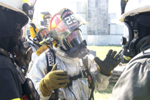 Firefighters discuss tactics and procedures during a training course at Scott Air Force Base, Ill., Aug. 31, 2016. The training featured firefighters from multiple bases and from the local community to include the 628th CES from Joint Base Charleston, South Carolina, the 19th CES from Little Rock AFB, Arkansas, the Mehlville Fire Protection District from St. Louis, Missouri, and the St. Louis Public Schools. (U.S. Air Force photo/Tech. Sgt. Jonathan Fowler)