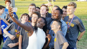 After the meet, the boys' team got to pose with Olympic Gold Medalist Dawn Harper-Nelson. The East St. Louis native won gold in the 100 meter hurdles in the 2008 Beijing Olympics. (Submitted Photo)