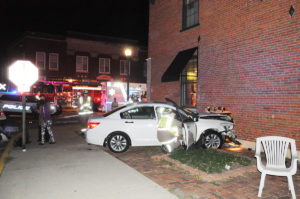 The white Honda Accord drove into the wall at Gia's Pizza in a three-car accident on October 18. Only minor injuries were reported by authorities.
