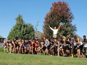 The starting gun is fired signaling the start of the race at the Cross Country Regionals. (Photo by Monica Ybarra)