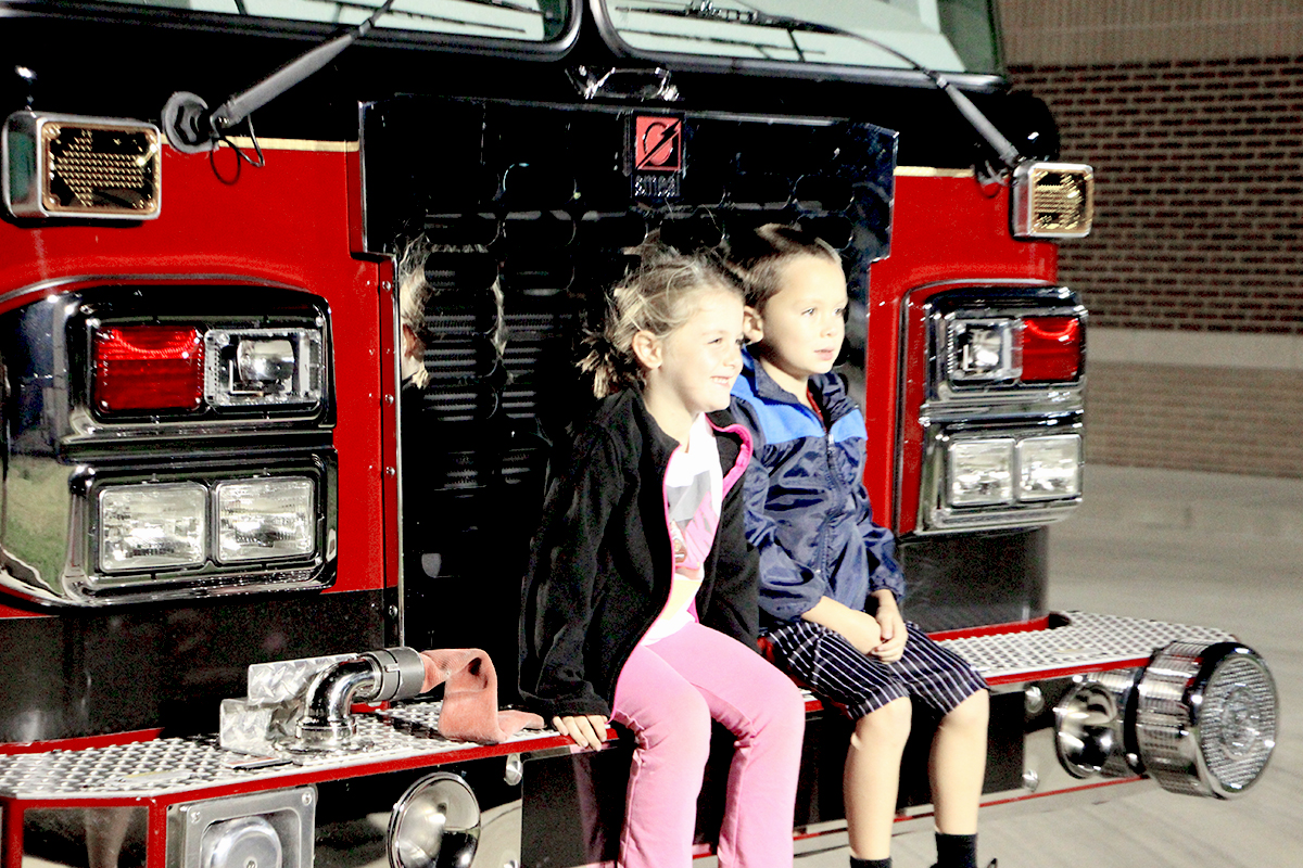 Children took opportunities to get up close and personal with the engines in the fire house. (O'Fallon Weekly Photo by Jeff Egbert)