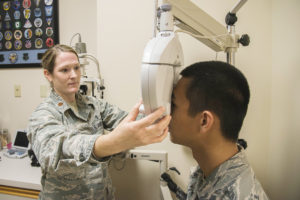 Maj. Kerry Phelan, 375th Aerospace Medicine optometry flight commander, performs an eye exam at the 375th Medical Group optometry department. Phelan will be awarded the overall Armed Forces Optometry Society Junior Optometrist of the Year 2016 on Nov. 8at the AFOS annual meeting in Anaheim, CA. (U.S. Air Force Photo by Airman 1st Class Daniel Garcia)