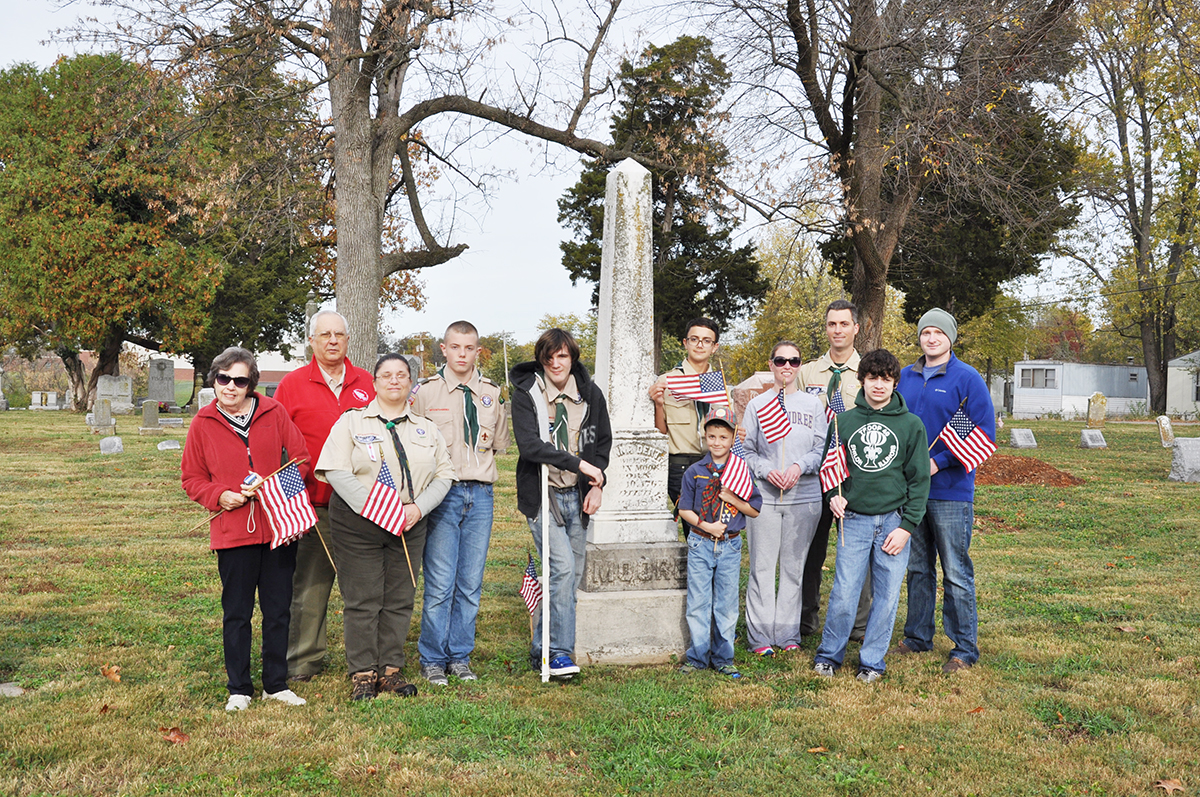 The group of volunteers standing at the Revolutionary War monument located in the cemetery. (O'Fallon Weekly Photos by Jeff Egbert)