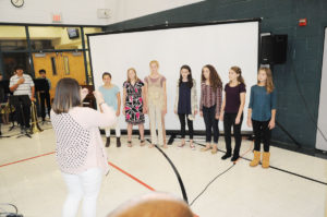 The all-district choir sings the National Anthem prior to the start of the District 90 Board of Education meeting. The District 90 band and all-district choir were honored by the board during the meeting. (O'Fallon Weekly Photo by Jeff Egbert)