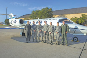 458th Airlift Squadron pilots and five Airmen pose in front of a C-21 prior to an incentive flight departing Scott Air Force Base, Ill., Oct. 18, 2016. The Airmen rewarded with this incentive flight were from around the base who showed hard work and dedication. (U.S. Air Force Photo by Senior Airman Megan Friedl)