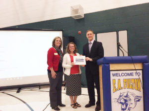 Amanda Mellenthin was recognized by the District 90 Board of Education at their November meeting for her Emerson Excellence in Teaching award. Pictured from left, Carriel Principal Ellen Hays, Mellenthin, and Board President John Wagnon. (Submitted Photo)