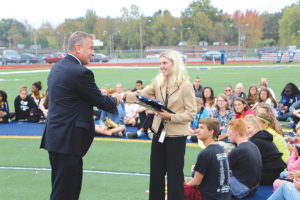 Congressman Mike Bost visited O'Fallon High School this fall to recognize the Marching Panthers on their success this season. Bost awarded Dr. Melissa Gustafson-Hinds with an Award of Congressional Recognition for their performance at U of I and their winning of the Governor's Cup for the second straight year. Additionally, he presented the school with a flag that flew over the Capitol Building in honor of the Marching Panthers. (O'Fallon Weekly Photo by Nick Miller)