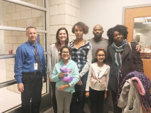 Rhylea Johnson, winner of the Award of Excellence for her essay on what Martin Luther King, Jr. day means to her stands with her family and principal. Pictured from left, front row: Jayla Johnson, Erica Johnson. Back row, from left: Shiloh Middle School Principal Jeff Alt, Christi Johnson, Rhylea Johnson, Eric Johnson, and Marilyn Johnson. (O'Fallon Weekly Photo by Angela Simmons)